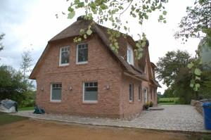 Einfamilienhaus mit Reetdach